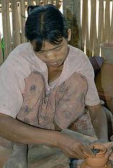 Intha woman doing pottery work