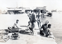 guys hanging around the harbour - doing what guys do. 1940'
