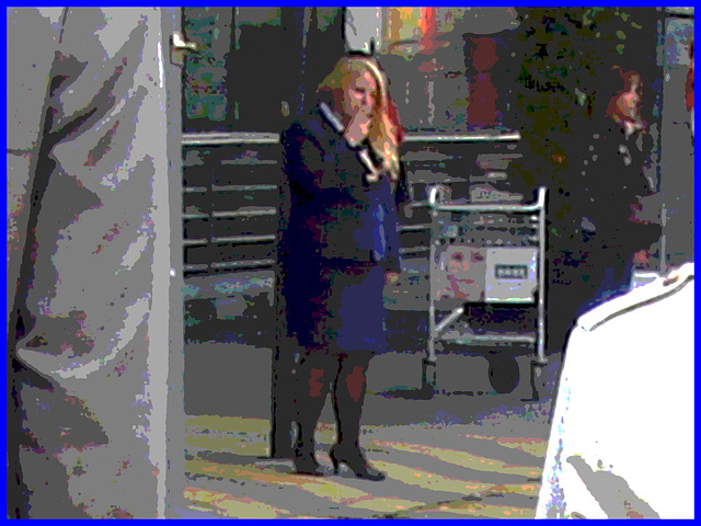 Distant blurry chubby blond flight attendant smoker in high heels  /  Hôtesse de l'air dodue en pause-cigarette - Brussels airport -19-10-2008 - Postérisation