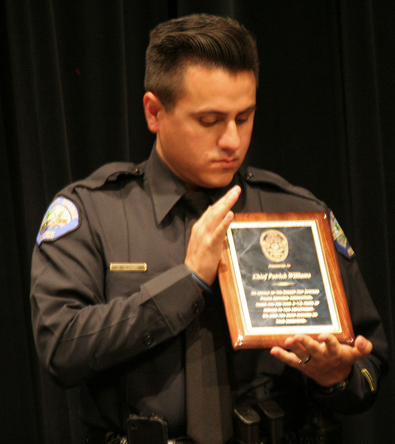 Officer Rene Olague with Plaque for Chief Williams (6445)