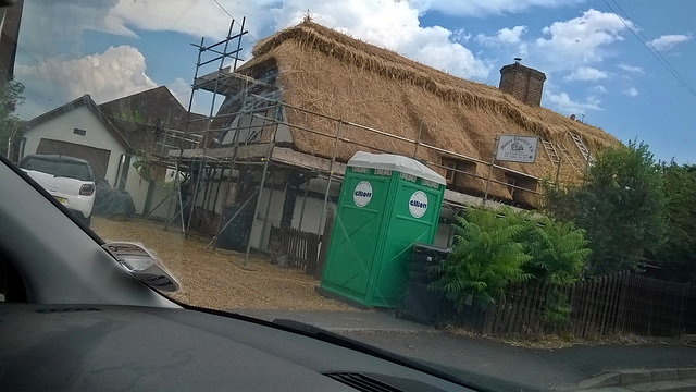 Drive-by snap of new thatch roof taking shape