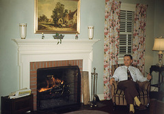 Pipe-Smoking Man in Front of the Fireplace
