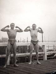 2 bodybuilders on a jetty, 1920'