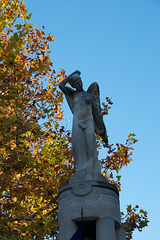 statue against the autumn trees