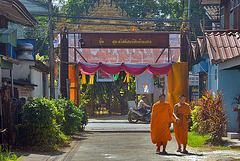 Monks enter the temple complex
