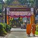 Monks enter the temple complex