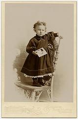 Girl Holding Photograph