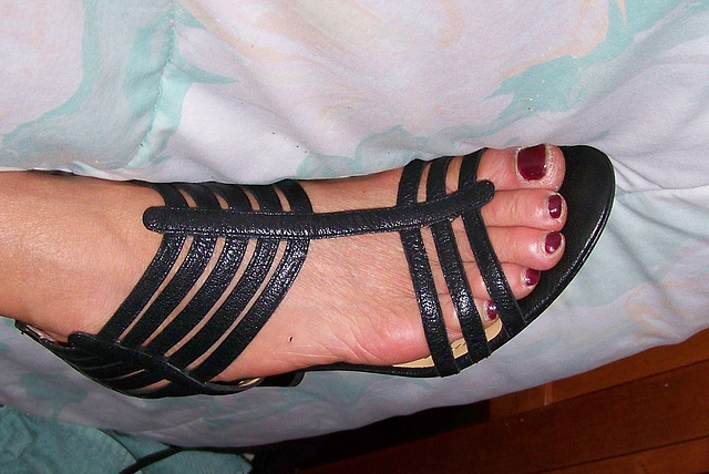 wife in nine west strappy heels