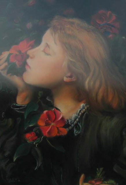 Young girl smelling a flower