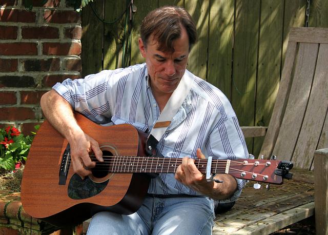 Guitarist in the garden