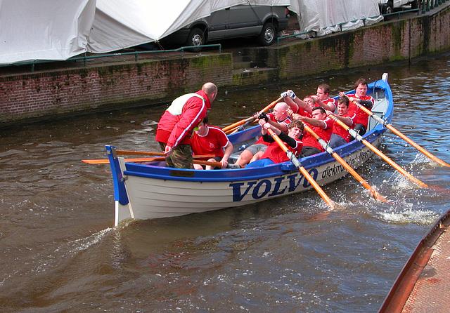 The oarsman on the left just broke his oar on the approach of a bridge