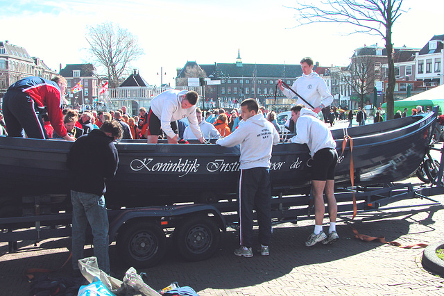 Navy cadets preparing their boat for transport