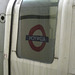 Station sign reflected in tube