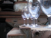 Machinery as glass collector, reflecting the Works