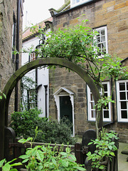 Wesley Cottage, through an arch.
