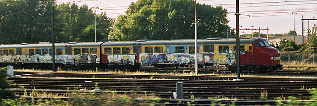Trains in three colours: Red, Yellow and Graffiti