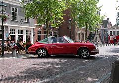 A visit to Wijk bij Duurstede - Woman trying to park her Porsche 911 T Targa