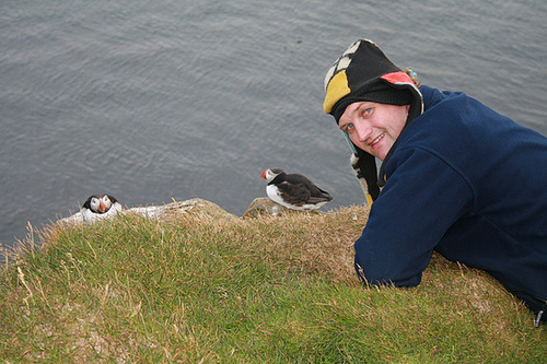 Richard checks out the puffins at the cliffs edge