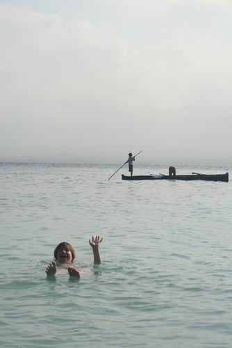 Jo waving - locals fishing