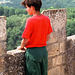 French boy looking at French countryside from a French castle
