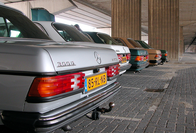Rear ends of some Mercedes W123s