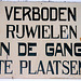 Academy Building of Leiden University just before a mayor refurbishment: old sign prohibiting bicycles in the hall