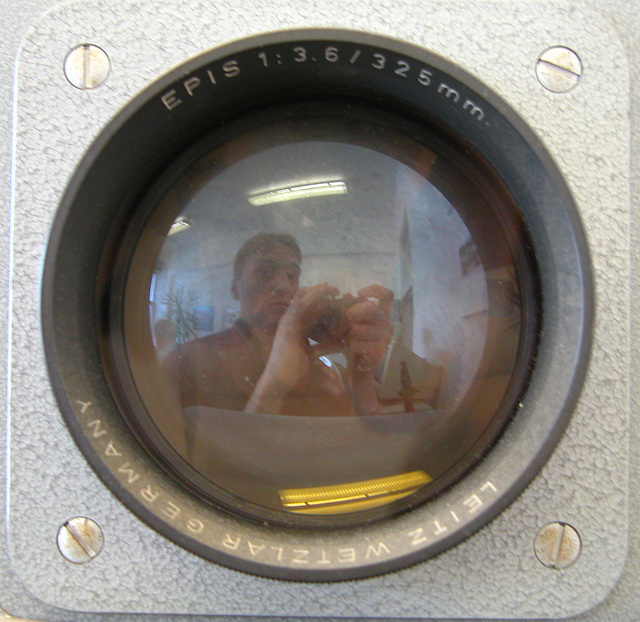 Me reflected in a Leitz projector lens
