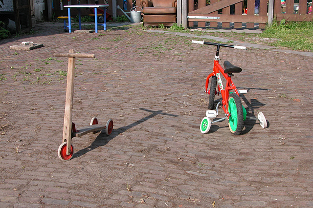 Abandoned child's scooter and bicycle