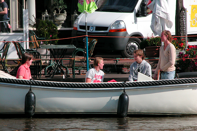 Students enjoying themselves in a boat