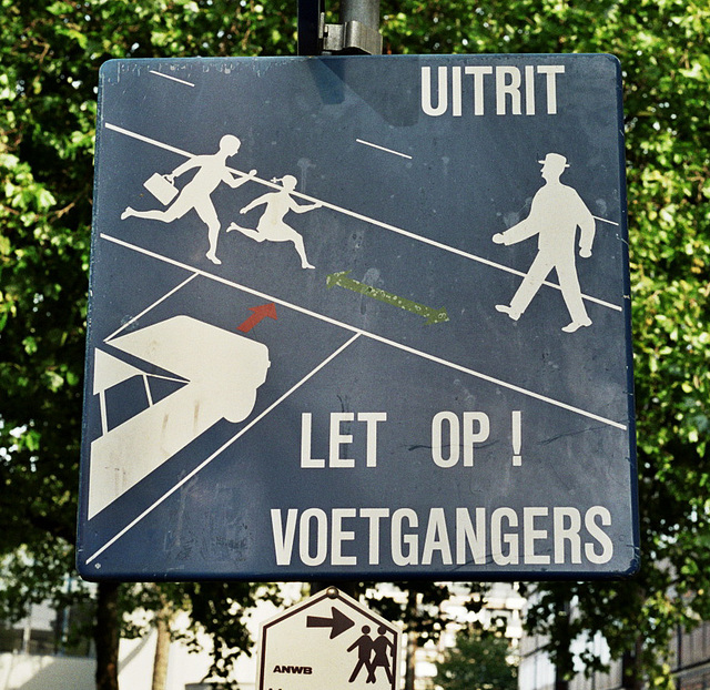 Sign warning against some 1950s pedestrians