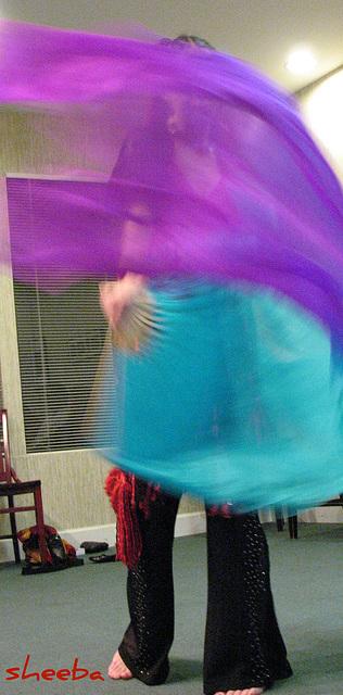 Enveloped by fan veils...