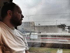 On a train in the rain