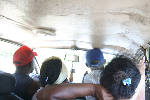 Three Adults Share the Front Seat in a Taxi