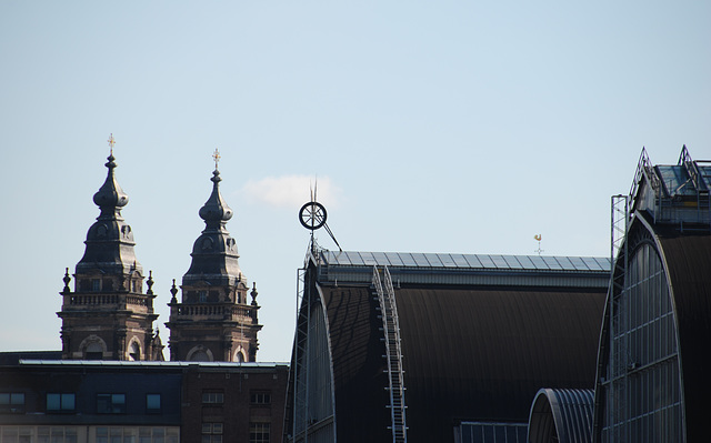 A trip with the steam tug Adelaar: Amsterdam Central Station and St. Nicolas Church