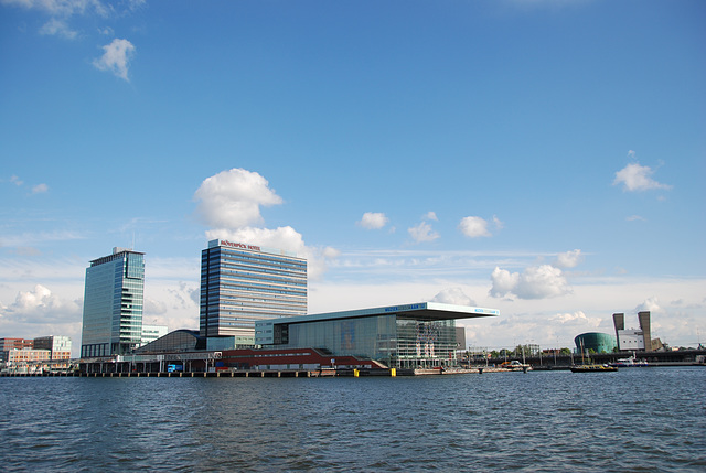 A trip with the steam tug Adelaar: high buildings along the IJ in Amsterdam