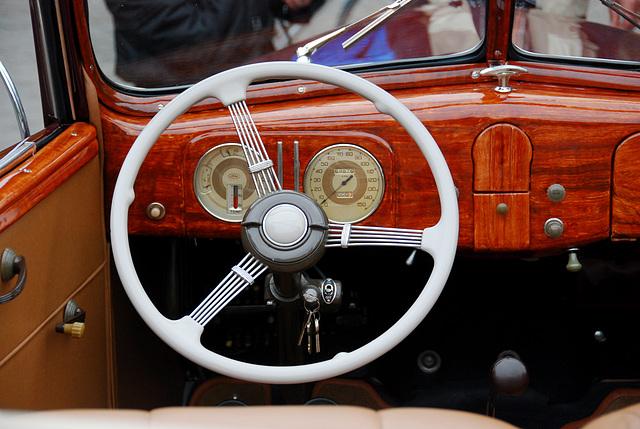 Wood dashboard of a 1937 Ford Club Cabriolet 78-760-B