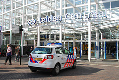 Police car in front of the Leiden Central railway station