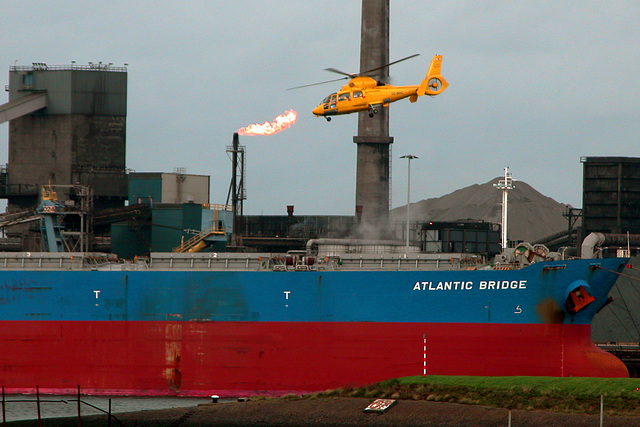 Flame, helicopter and ship