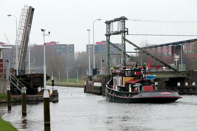 Ship passing the railway bridge near Leiden