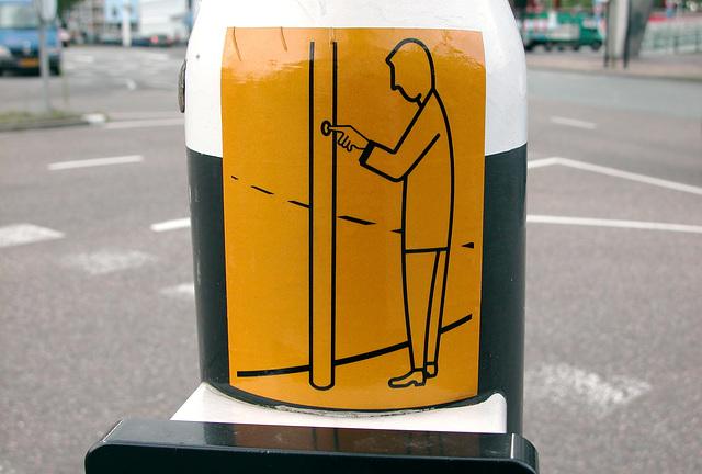 Faceless yellow man presses a button