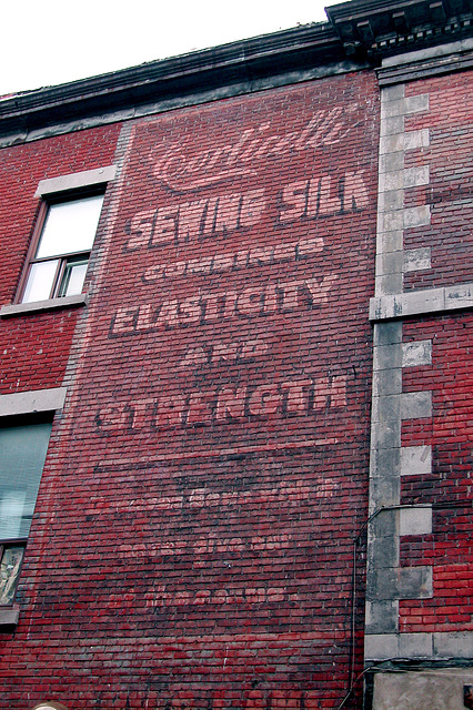 Faded wall ad in Montreal, Quebec