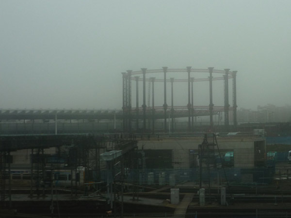 Gasometer in the fog