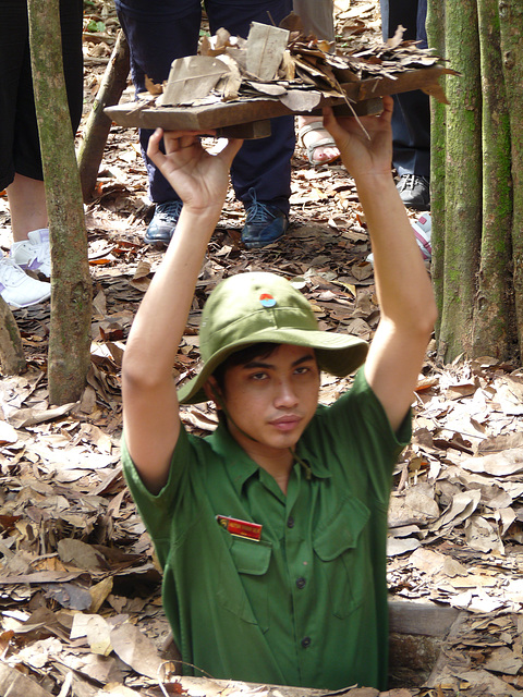 Demonstrating Viet Cong Concealment Techniques