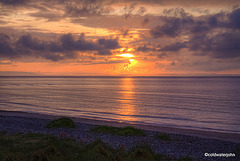 Findhorn Beach with a sun setting over the Moray Firth