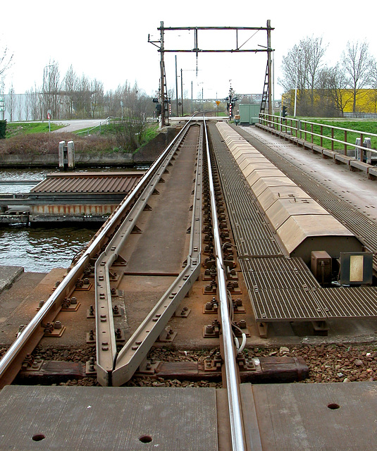 Rail bridge at Alphen aan den Rijn with mechanical sign