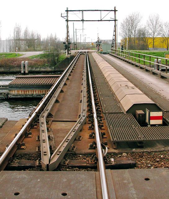 Rail bridge at Alphen aan den Rijn with mechanical sign
