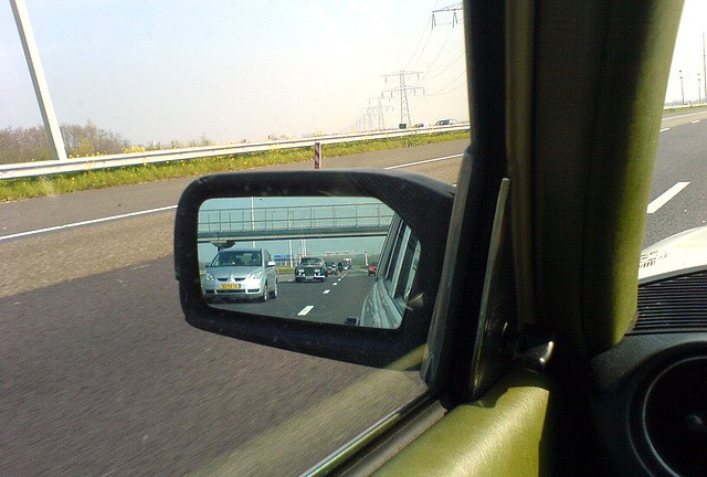 1964 Rolls-Royce Silver Cloud III in the side-view mirror
