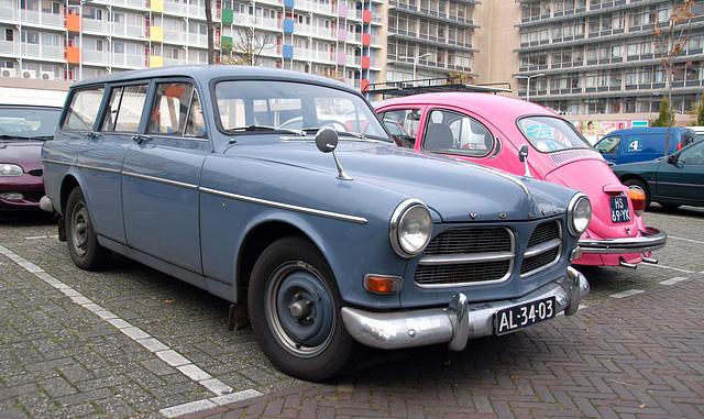 Blue Volvo and Pink Volkswagen