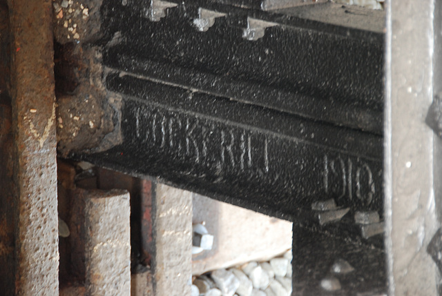 The names of famous steel factories on the buffer stops at Haarlem Station: Cockerill