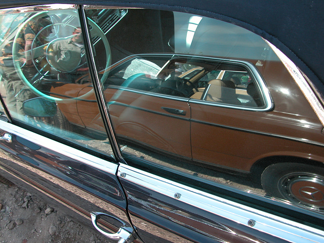 A Mercedes-Benz W123 Coupe reflected in a Mercedes-Benz 250 SE